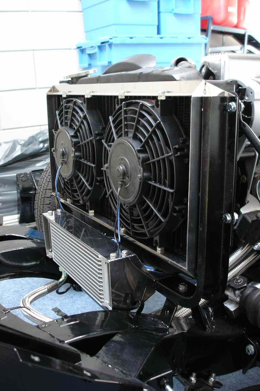 Stainless steel oil cooler mounting with air duct